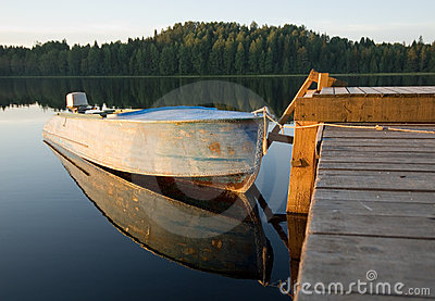 Boat reflecting in calm waters