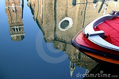 A boat and a reflection