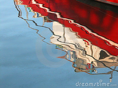 Red Boat reflection on water