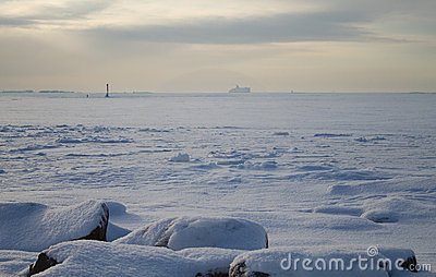 Boat sailing on frozen sea