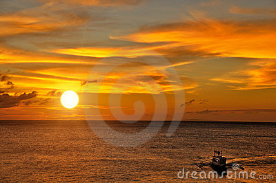Boat Sailing into the Sunset