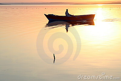 Boat silhouette golden water
