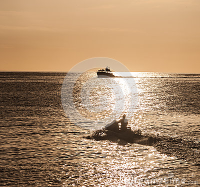 Boat silhouetted in the setting sun