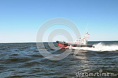 Boat speeding across water