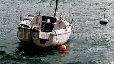 Boat by stormy weather. White boat moving a lot on the water lake by stormy weather stock footage