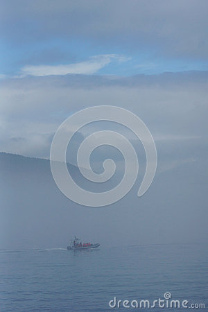 Boat on water in the fog