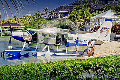 Boater photographing Sea Plane at Abaco Inn, Elbo Cay Abaco, Bahamas Editorial Stock Image