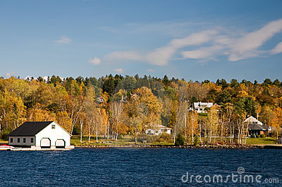 Boathouse on lake in fall