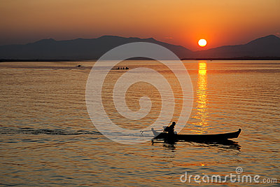 Boatman at Sunset Editorial Image