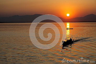 Boatman at Sunset Editorial Photo