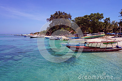Boats along Gili Air Island s shoreline