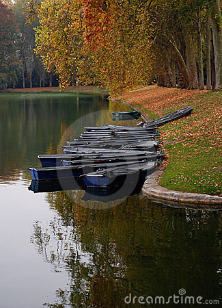 Boats along river in Autumn
