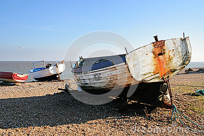 Boats beached on a shingle beach