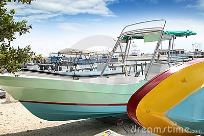 Boats colorful in Isla Mujeres beach Mexico