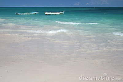 Boats in green ocean, White Sand Beach