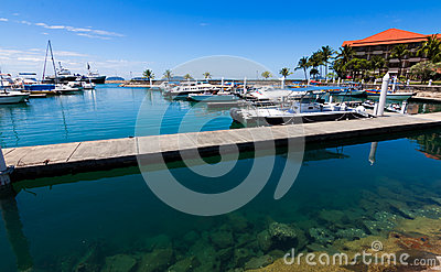 Boats at a harbor with blue sky
