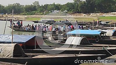 Boats at Jamuna river banks in Sariakandi Ghat near Bogra, Bangladesh. BOGRA, BANGLADESH - NOVEMBER 7, 2016: Boats at Jamuna river banks in Sariakandi Ghat near stock footage