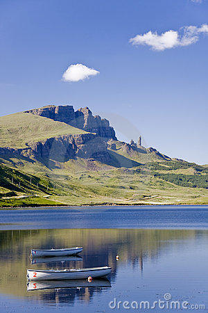 Boats on Loch leathann with the old man of storr