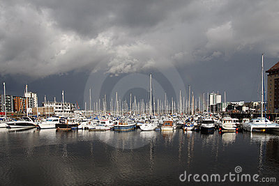 Boats in a marina with stormy sky