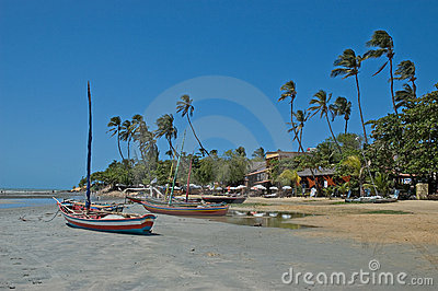 Boats moored on tropical beach