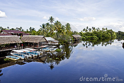 Boats moored on tropical river