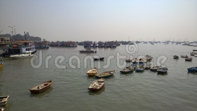 Boats in the Mumbai Harbor. Boats floating in the harbor in Mumbai at the Gate of India or the Mumbai archway stock video