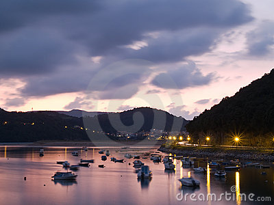 Boats at the natural district of Urdaibai at dusk