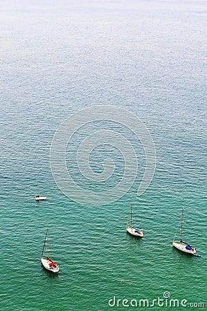 Boats and platform on Nazare Sea
