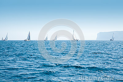 Boats sail regatta with sailboats in mediterranean