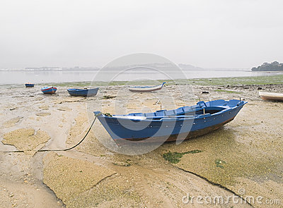 Boats in the sand on a cloudy day
