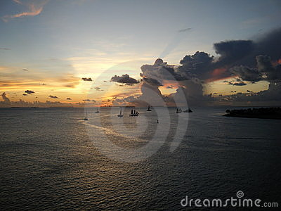 Boats silhouetted at sunset