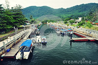Boats in Small scenic river of Tioman island, Mala