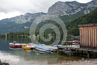 Boats tied to old pier, lake Toplitzsee, Austria