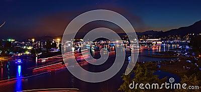 Boats travelling at night at Vancouver Canada