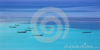 Boats at turquoise sea