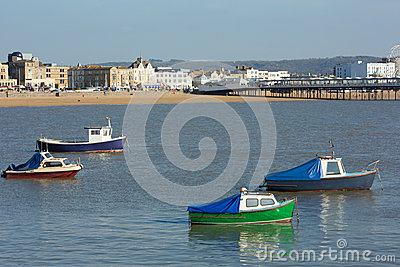 Boats and Pier in Weston-super-Mare bay and sea front view