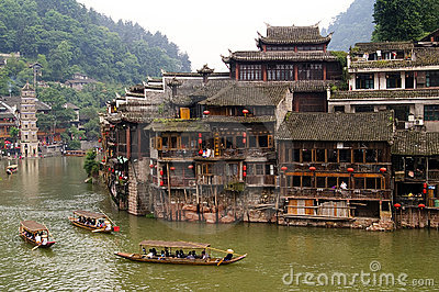 Boats and wooden houses at Phoenix Town, Tuojiang