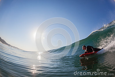 Body-Boarder Glass Wave Surfing  Editorial Photo
