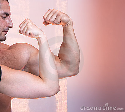 Body builder portrait with biceps muscle i