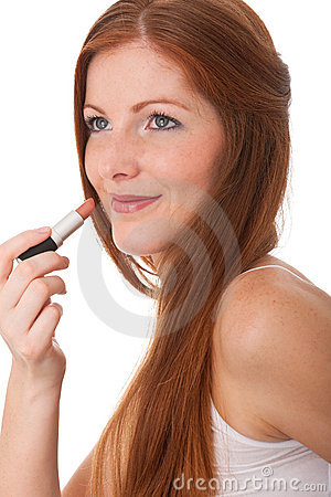 Body care - Young woman apply lipstick