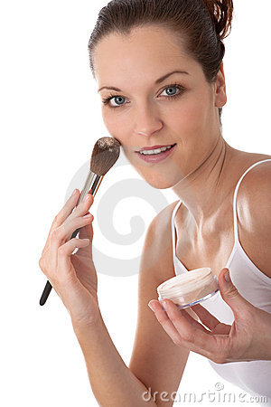 Body care - Young woman apply powder