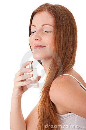 Body care - Young woman enjoy smell of perfum