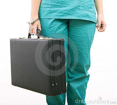 Body from pinned to suitcase with handcuffs hand