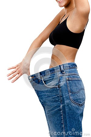Body of a slim girl wearing huge jeans