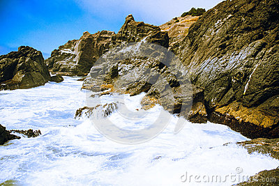 Body Of Water Near Rock Formation Under Clear Blue Sky Free Public Domain Cc0 Image