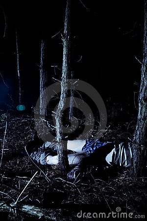 Body in woods at night