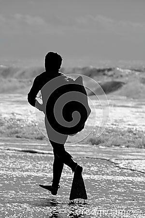 Bodyboard surfer running