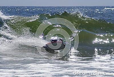 Bodyboarder rides wave in Cornwall
