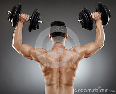 Bodybuilder back with dumbbells