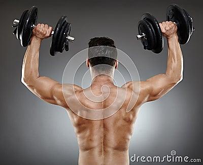Bodybuilder back with dumbbells